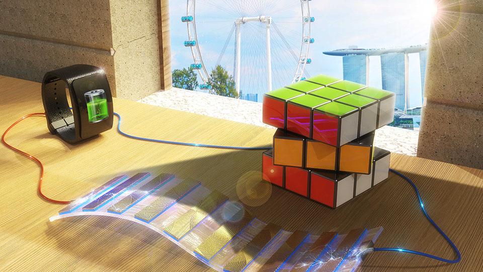 La presenza del cubo di Rubik crea un contrasto di luce e ombra sul SEG, la condizione che consente di generare energia, nella fattispecie alimentando uno smart watch. (Foto da:  Royal Society of Chemistry)  energia contrasto ombra  energia contrasto ombra